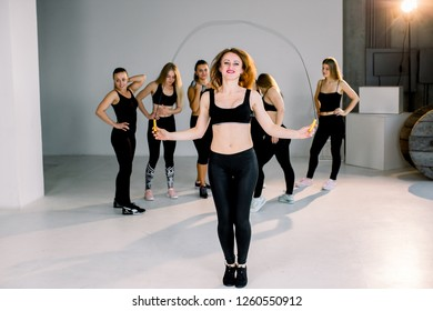 Fitness woman skipping with a jump rope in the gym. Female doing fitness training in morning. Young sport girls are ready for the work out training. Healthy lifestyle concept.