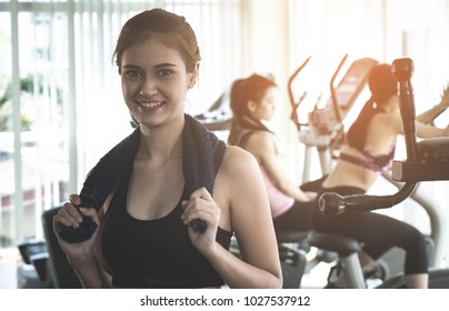 Fitness woman smiling with friend work out in the background