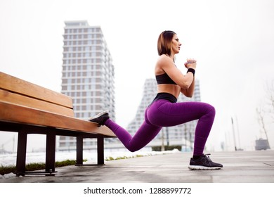 Fitness woman split squat exercise outdoor
