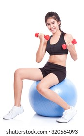 Fitness woman sport training with exercise ball and lifting weights