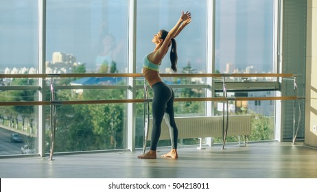 Fitness woman stretching in the gym. Barre