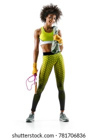 Fitness woman is sweaty. Photo of smiling african girl with skipping rope and towel in hands on white background. Resting time.
