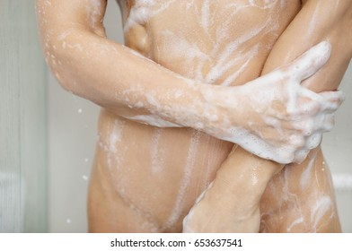 Fitness woman taking shower after work out.