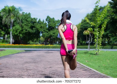 Fitness woman training and jogging in the park. Healthy and sport concept