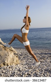Fitness woman training on the beach