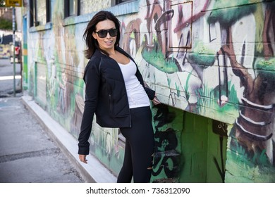 Fitness woman in the urban city outdoors in Toronto, Canada. Mixed race Asian Caucasian female model.