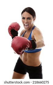 fitness woman wearing boxing gloves with lots of energy punching out