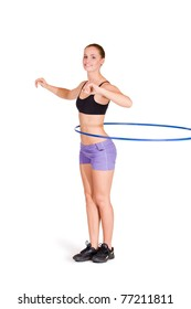 fitness woman working with hula hoop smiling isolated in white