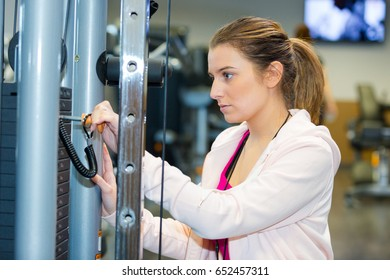 fitness woman working out in fitness center