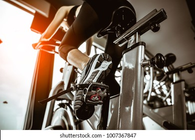 Fitness woman working out on exercise bike at the gym.exercising concept.fitness and healthy lifestyle