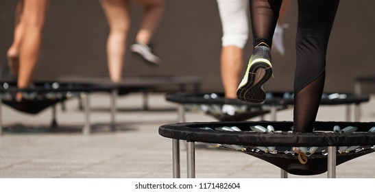Fitness women jumping on small trampolines,exercise on rebounder