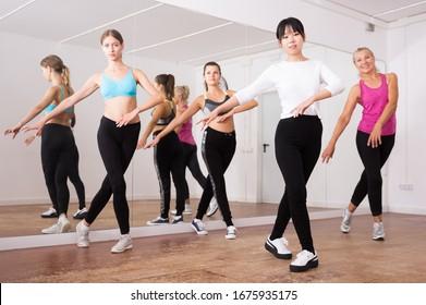 Fitness women practicing zumba movements