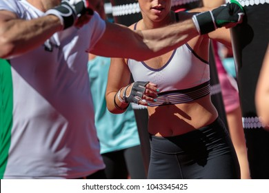 Fitness Workout: Girl Doing Exercises in Class at Gym.