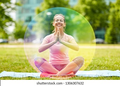 fitness, yoga and healthy lifestyle concept - happy woman meditating in summer park over rainbow aura
