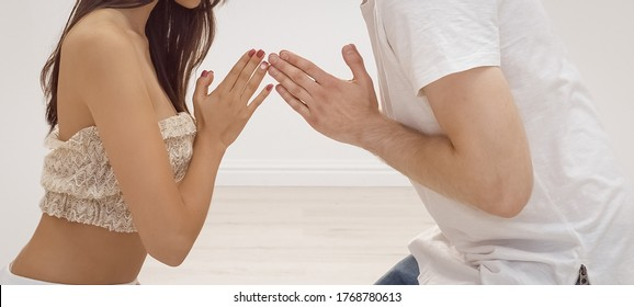 Fitness, yoga and healthy lifestyle concept - Group of young multi-ethnic beautiful couples sitting together with closed eyes indoors on tantra courses.