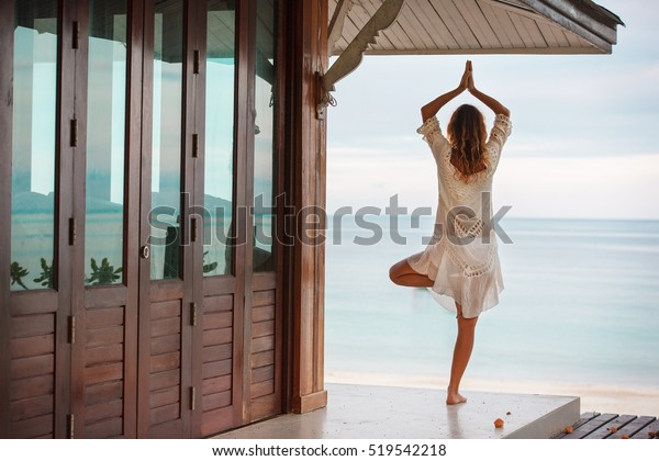 fitness, yoga, perfect tanned body, healthy skin. Travel and Vacation. Freedom Concept. Outdoor shot