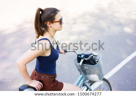 Fitness young woman with bike girl on bicycle