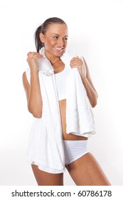 Fitness young woman with water bottle in hand and towel around her neck