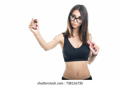 Fitt girl holding tablet blister and writing with marker isolated on white background with copyspace advertising area