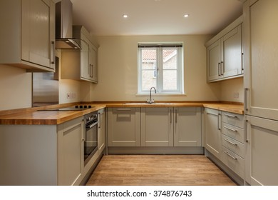 Fitted kitchen with built-in appliances
