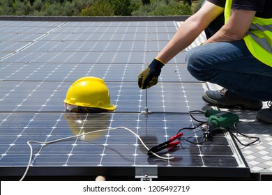 fitting photovoltaic panels on a roof  of a building