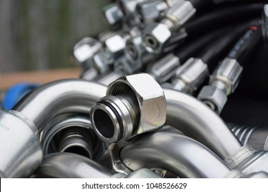 Fittings and hydraulic hoses