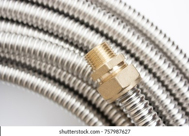 Fittings for pipe fastening. Threaded connection of stainless corrugated pipe, isolated photo on white background