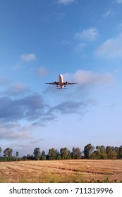 Fiumicino, Italy - Circa September, 2017: Bottom view of airplane flying above the fields near airport Rome-Fiumicino