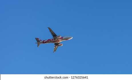 Fiumicino Leonardo da Vinci International Airport, Metropolitan City of Rome / Italy - 01 04 2019: Ernest airlines plane Airbus A320-233 reg EI-GCC after take off. Flying aircraft bottom view.