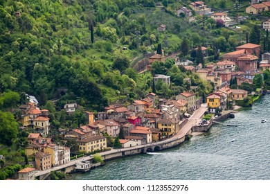 Fiumilatte sergio river flowing through the village of Varena, Italy