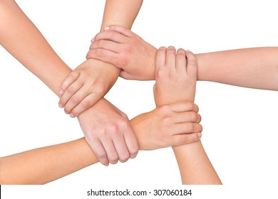 Five arms with hands of girls holding each other joining on white background