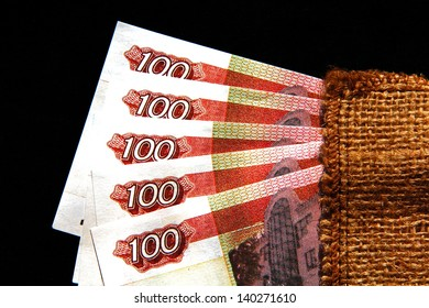 five banknotes in denominations of one hundred units on a dark blue background.