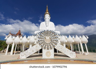 Five big white buddha sculptures with mountain and white cloud with blue sky phasornkaew temple in khao kho Phetchabun Thailand.