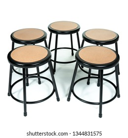 five black metal stools on a white background