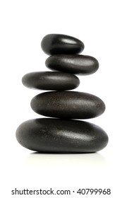 Five black stones balanced isolated over white background
