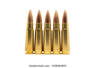 Five bullets isolated on white background. Cartridges 7.62 caliber for Kalashnikov assault rifle closeup.