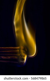 Five Burning Matchsticks with orange flames on a dark background