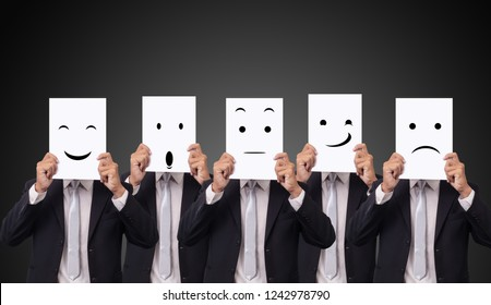 five businessman holding a card with drawing facial expressions different emotion feelings face on white paper
