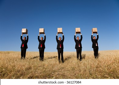 five businessman lineup holding a cardboard box over his head