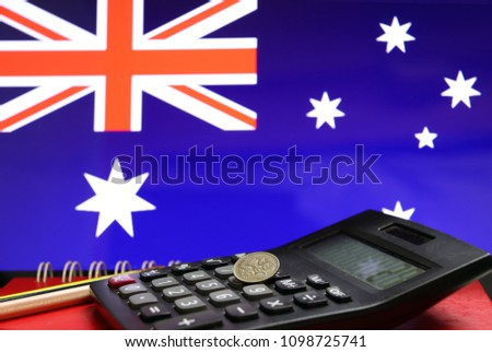Five Cents Coin Of Australia On The Calculator With Pencils On The Red Floor And Blue