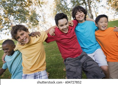 Five children, boys running with their arms around each other,