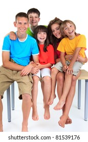 Five children sitting on table
