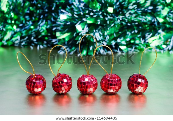 Five christmas balls in the line