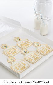 Five (church shaped) cookies with milk bottles