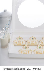 Five (church shaped) cookies in white box, cookie jar and two milk bottle. Shot with copy space.