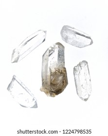 Five Clear Quartz Crystal Points Over White from above, Not Isolated. Used for healing and energy work. Lit from beneath.