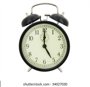 Five of clock. Old alarm clock on white background