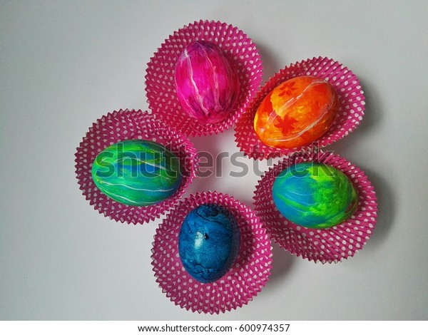 five colorful painted easter eggs in a circle