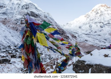 Five colour Nepal flag with Annapurna snow mountain background