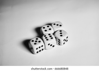 Five dices laying in one batch